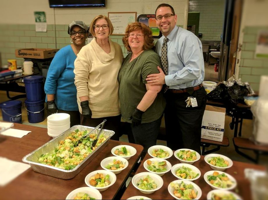 Principal Selkman often volunteers his time to support our fundraising efforts. Here he is helping our Music Booster volunteer serve salad at our Spaghetti dinner fundraiser.